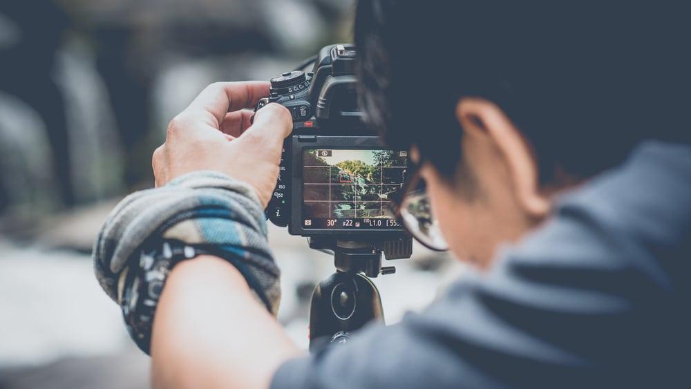 Avid photographer taking a photograph
